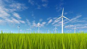 Rotating wind turbines and green grass 4K stock video