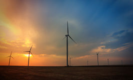 Rotating wind turbines at sunset Royalty Free Stock Image