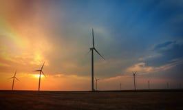 Rotating wind turbines at sunset Royalty Free Stock Image