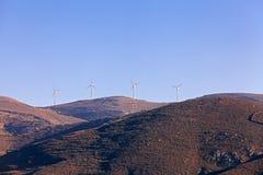 Rotating windmill on Greece island Stock Photos