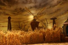 Rotating windmill for pumping water Royalty Free Stock Images