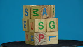 Rotating wooden cubes with alphabetical letters stock video