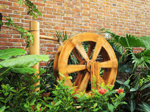 Water wheel. A rotating wooden water wheel is driven by water Stock Images