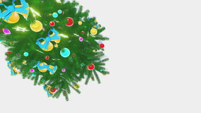 Rotating Xmas tree on white background top-down view stock footage