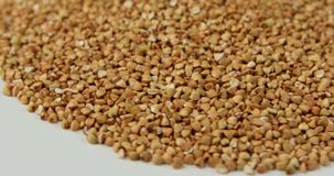Rotation of the background of whole grains of buckwheat. stock video footage