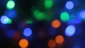 Rotation of the colorful and blinking Christmas bokeh. Abstract background with bokeh stock footage