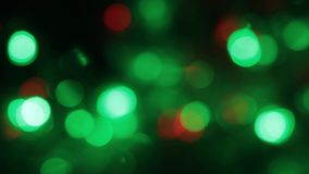 Rotation of the colorful and blinking Christmas bokeh. Abstract background with bokeh, stock video