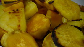 Rotation of delicious fried sweet potatoes. stock footage