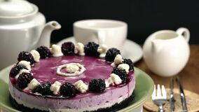 Rotation of delicious homemade blackberry cheesecake.