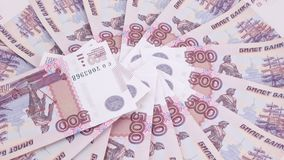 Consecutive numbers on rubles. Rotation of new banknotes of Russian rubles with the numbers in order stock footage