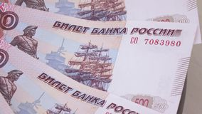 Consecutive numbers on rubles. Rotation of new banknotes of Russian rubles with the numbers in order stock video