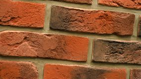 Rotation of red decorative brick with cracks. Brickwork background. Figure block. Clear place for your isolated text pattern. Empty space for your title copy stock video footage