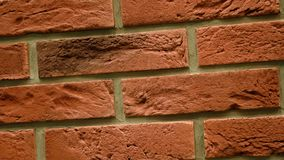 Rotation of red decorative brick with cracks. Brickwork background. Figure block. Clear place for your isolated text pattern. Empty space for your title copy stock video