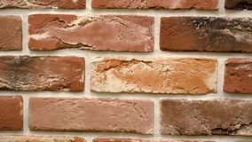 Rotation of red decorative brick with cracks. Brickwork background. Figure block. Clear place for your isolated text pattern. Empty space for your title copy stock footage