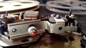 Old retro reel audio recorder reels spinning. Rotation reel with tape on the video, audio tape recorder player. Closeup stock video footage