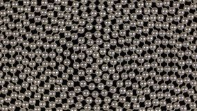 Rotation of a spiral of white beads lying on a black cloth. View from above stock video footage
