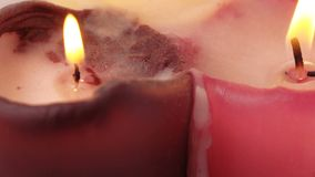 Burning wax candles. Rotation of three burning wax candles stock video footage