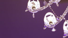 Rotation under crystal chandelier Royalty Free Stock Photo