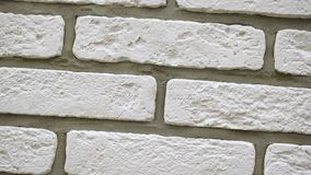 Rotation of white decorative bricks for home. Brickwork background. Figure block. Clear place for your isolated text pattern. Empty space for your title copy stock video