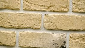 Rotation of yellow decorative brick for home. Brickwork background. Figure block. Clear place for your isolated text pattern. Empty space for your title copy stock footage