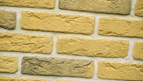 Rotation of yellow decorative brick for home. Brickwork background. Figure block. Clear place for your isolated text pattern. Empty space for your title copy stock video footage