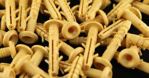 The rotation of the yellow dowels. The rotation of the yellow dowels stock video footage
