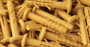 The rotation of the yellow dowels. The rotation of the yellow dowels stock footage