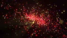 Rotationen av partiklarna av olika färger och ljusa strålar lager videofilmer