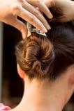 Rotazione dei capelli da dietro fotografia stock