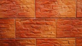 Rotbraune, dekorative Backsteinmauer für den Hintergrund lizenzfreie stockbilder