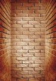 Rotbraunes getontes Backsteinmauerende des Korridors, abstraktes backgro Lizenzfreie Stockbilder