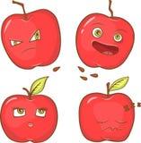Rote Äpfel mit Gesichtern Stockfotografie