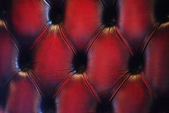 Rote Abbildung der Polsterung des echten Leders Stockfotografie