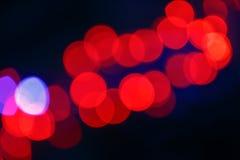 Rote Abstraktion von bokeh auf dem schwarzen Hintergrund Stockbilder