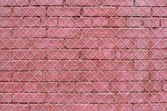 Rote alte Backsteinmauer mit Eisengitter Lizenzfreie Stockbilder
