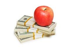 Rote Apfel- und Dollaranmerkungen Stockfotos