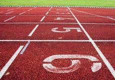 Rote athletische Spur Lizenzfreie Stockfotografie