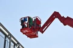 Rote Aufnahmevorrichtung des hydraulischen Aufbaus stockfoto