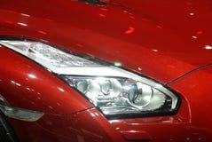 Rote Auto-Scheinwerfer Lizenzfreies Stockfoto