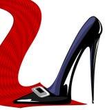 rote Bindung und schwarzer Schuh Stockfoto