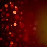 Rote bokeh Weihnachtshintergrundblasen Stockfotografie