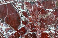 Rote, braune Marmorbeschaffenheit mit weißen Streifen Stockbild