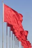 Rote chinesische Markierungsfahnen, Symbol von Kommunismus Stockfotografie