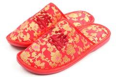 Rote chinesische Schuhe Stockfotos