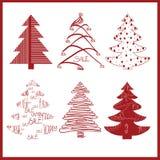 Rote dekorative Tannenbäume auf einem weißen Hintergrund Lizenzfreies Stockfoto