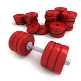 Rote Dumbbells und Haufen der Gewichte Lizenzfreies Stockbild