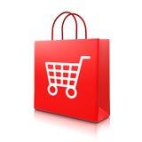 Rote Einkaufstasche mit Warenkorb Stockbild