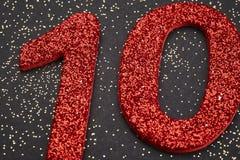 Rote Farbe der Nr. zehn über einem schwarzen Hintergrund jahrestag Stockfoto