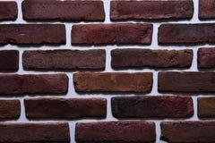 Rote Farbe des alten Backsteinmauermusters von dekorativem ungleichem des modernen Artdesigns Stockfotos