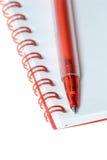 Rote Feder und Notizbuch Lizenzfreies Stockbild